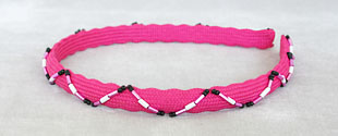 Scalloped hot pink hair band decorated with seed and bugle beads