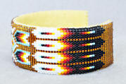 a3074a Clear gold/flame feather/arrow wide beadwork cuff, side view