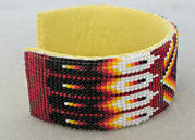 a3237a Clear red/flame beaded eagle feather/diamond pattern cuff bracelet, side view