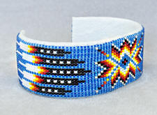 a3271 Clear sky blue/flame feather/arrow wide beadwork cuff, side view